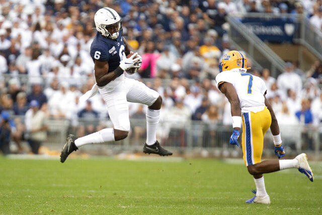 FILE - In this Sept. 14, 2019, file photo, Penn State wide receiver Justin Shorter (6) attempts to catch a pass as Pittsburgh defensive back Jazzee Stocker (7) defends during an NCAA college football game in State College, Pa. The former Penn State is eligible to play for No. 8 Florida this season. The Gators say the NCAA has granted Shorter's request to waive a one-year transfer rule. (AP Photo/Barry Reeger, File)