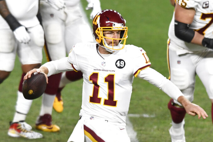 Washington Football Team quarterback Alex Smith (11) looks to throw a pass during the first half of an NFL football game against the Pittsburgh Steelers in Pittsburgh, Monday, Dec. 7, 2020. (AP Photo/Barry Reeger)