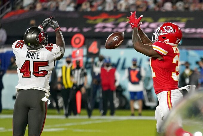 Tampa Bay Buccaneers inside linebacker Devin White (45) breaks up a pass intended for Kansas City Chiefs running back Darrel Williams, right, during the second half of the NFL Super Bowl 55 football game, Sunday, Feb. 7, 2021, in Tampa, Fla. (AP Photo/Lynne Sladky)