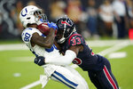 Indianapolis Colts wide receiver Chester Rogers (80) is hit by Houston Texans defensive back A.J. Moore (33) on a punt return during the first half of an NFL football game Thursday, Nov. 21, 2019, in Houston. (AP Photo/David J. Phillip)