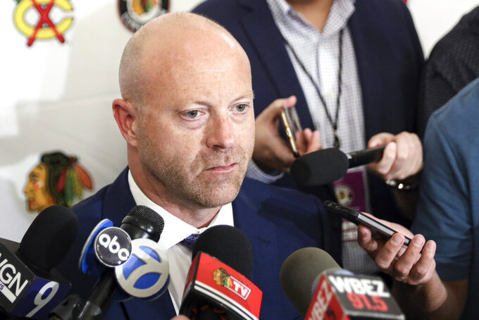 FILE- In this July 26, 2019, file photo, Chicago Blackhawks senior vice president and general manager Stan Bowman speaks to the media during the NHL hockey team's convention in Chicago. Bowman resigned Tuesday, Oct. 26, 2021, following an investigation into allegations that an assistant coach sexually assaulted a player in 2010. (AP Photo/Amr Alfiky, File)