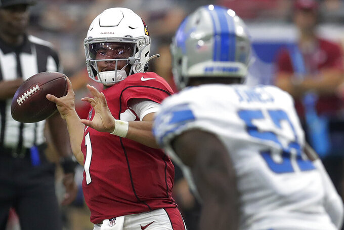 Arizona Cardinals quarterback Kyler Murray throws during the second half of an NFL football game as Detroit Lions outside linebacker Christian Jones looks on, Sunday, Sept. 8, 2019, in Glendale, Ariz. (AP Photo/Darryl Webb)