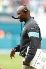 Miami Dolphins head coach Brian Flores gestures, during the first half at an NFL football game against the Cincinnati Bengals, Sunday, Dec. 22, 2019, in Miami Gardens, Fla. (AP Photo/Brynn Anderson)