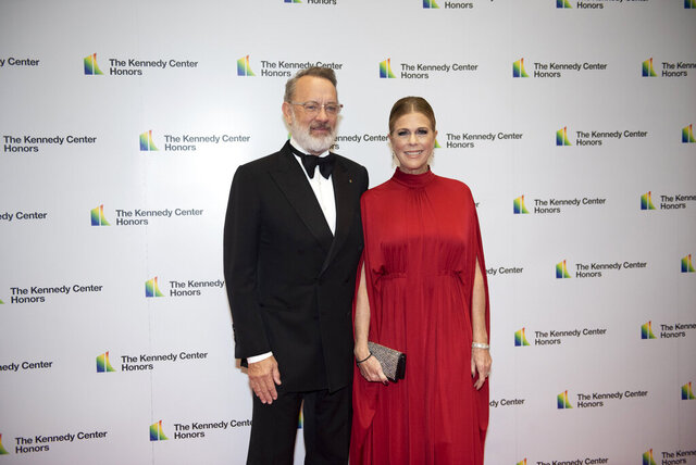 2014 Kennedy Center Honoree Tom Hanks and his wife, Rita Wilson, arrive at the State Department for the Kennedy Center Honors State Department Dinner on Saturday, Dec. 7, 2019, in Washington. (AP Photo/Kevin Wolf)
