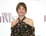 """FILE - Actress Helen McCrory poses for photographers at a special screening of """"Their Finest"""" at the BFI in central London on April 12, 2017. McCrory, who starred in the television show """"Peaky Blinders"""" and the """"Harry Potter"""" movies, has died. She was 52 and had been suffering from cancer. Her husband, actor Damian Lewis, said Friday that McCrory died """"peacefully at home"""" after a """"heroic battle with cancer."""" (Photo by Joel Ryan/Invision/AP, File)"""