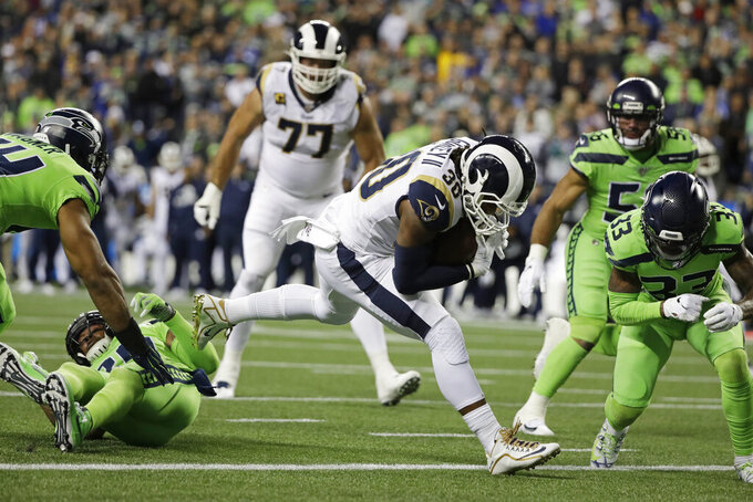 Los Angeles Rams running back Todd Gurley, center, rushes for a touchdown against the Seattle Seahawks during the second half of an NFL football game Thursday, Oct. 3, 2019, in Seattle. (AP Photo/Elaine Thompson)