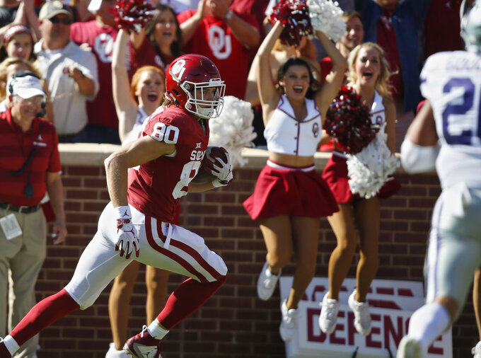 Oklahoma tight end Grant Calcaterra (80) keeps an eye on Kansas State defensive back Denzel Goolsby, right, as he runs into the endzone for a touchdown in the first half of an NCAA college football game in Norman, Okla., Saturday, Oct. 27, 2018. (AP Photo/Sue Ogrocki)