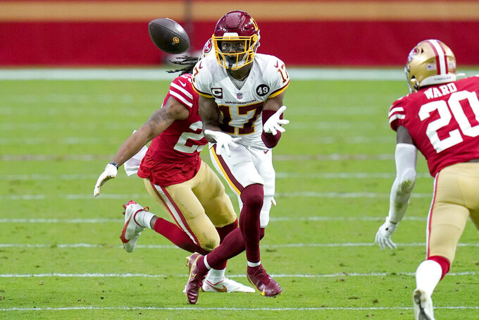 Washington Football Team wide receiver Terry McLaurin (17) makes a catch as San Francisco 49ers cornerback Richard Sherman defends during the first half of an NFL football game, Sunday, Dec. 13, 2020, in Glendale, Ariz. (AP Photo/Ross D. Franklin)