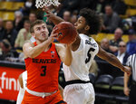 Oregon State forward Tres Tinkle, left, goes up for a basket past Colorado guard D'Shawn Schwartz in the first half of an NCAA college basketball game Thursday, Jan. 31, 2019, in Boulder, Colo. (AP Photo/David Zalubowski)