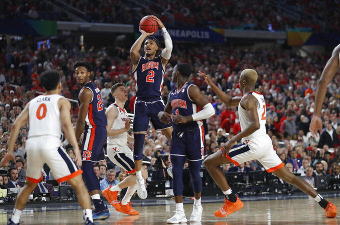 Auburn's Bryce Brown (2) takes a shot during the second half in the semifinals of the Final Four NCAA college basketball tournament against Virginia, Saturday, April 6, 2019, in Minneapolis. (AP Photo/Jeff Roberson)