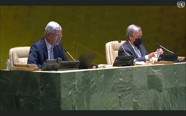 In this image made from UNTV video, United Nations General Assembly President Volkan Bozkir, left, introduces UN Secretary-General Antonio Guterres, right, during the 75th session of the United Nations General Assembly, Tuesday, Sept. 22, 2020, at U.N. headquarters in New York. The U.N.'s first virtual meeting of world leaders started Tuesday with pre-recorded speeches from some of the planet's biggest powers, kept at home by the coronavirus pandemic that will likely be a dominant theme at their video gathering this year. (UNTV via AP)