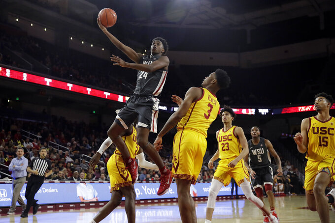 Washington State's Noah Williams (24) shoots over Southern California's Elijah Weaver (3) during the second half of an NCAA college basketball game Saturday, Feb. 15, 2020, in Los Angeles. (AP Photo/Marcio Jose Sanchez)