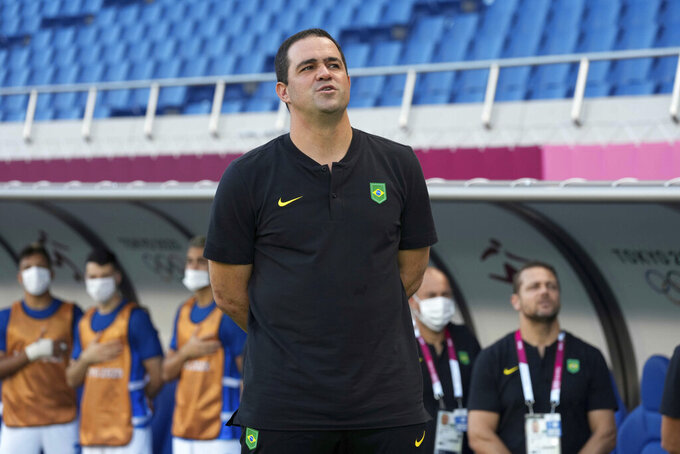 Brazil's coach Andre Jardine sings the national anthem before a men's soccer match against Saudi Arabia at the 2020 Summer Olympics, Wednesday, July 28, 2021, in Saitama, Japan. (AP Photo/Martin Mejia)