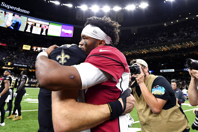 Arizona Cardinals quarterback Kyler Murray, right, hugs New Orleans Saints quarterback Drew Brees after their NFL football game in New Orleans, Sunday, Oct. 27, 2019. The Saints won 31-9. (AP Photo/Bill Feig)