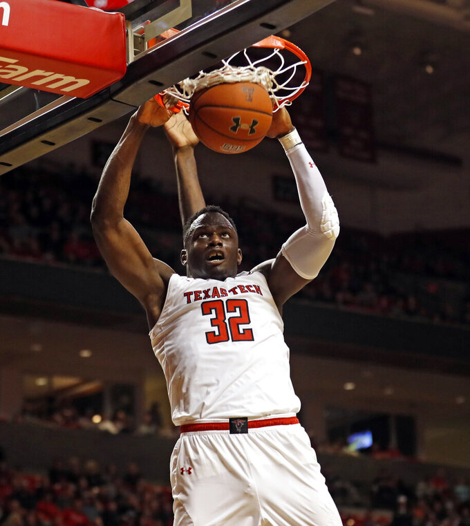 Texas Tech's Norense Odiase (32) dunks the ball during the second half of an NCAA college basketball game against West Virginia, Monday, Feb. 4, 2019, in Lubbock, Texas. (AP Photo/Brad Tollefson)