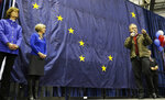 FILE - Alaska Gov. Sean Parnell, right, speaks in front of a giant state of Alaska flag as his wife Sandy, second from left, and U.S. Sen. Lisa Murkowski, R-Alaska, left, look on at a campaign rally, in a Monday, Nov. 3, 2014 file photo, in Anchorage Alaska. The fate of one of Alaska's most historic yet neglected structures could be decided Monday, July 13, 2020. City officials in Seward will decide whether to demolish the Jesse Lee Home, a former Methodist boarding school where the Alaska territorial flag was first flown almost a century ago and where its Alaska Native designer, Benny Benson, lived.  (AP Photo/Ted S. Warren, File)