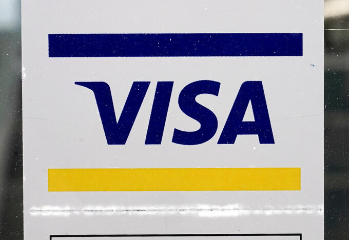 File- This April 27, 2021, file photo shows a Visa sign displayed on the front door of a local business in Urbandale, Iowa. Simone Biles' sponsors including Athleta and Visa are lauding her decision to put her mental health first and withdraw from the gymnastics team competition during the Olympics. It's the latest example of sponsors praising athletes who are increasingly open about mental health issues. (AP Photo/Charlie Neibergall, File)
