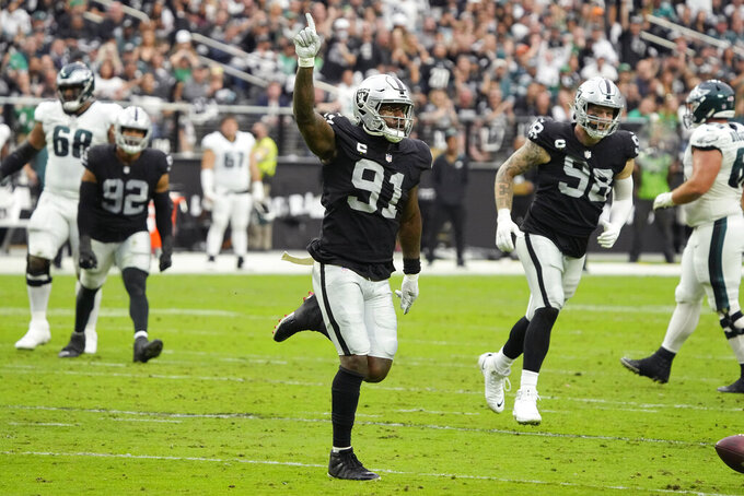 Las Vegas Raiders defensive end Yannick Ngakoue (91) celebrates after blocking a pass attempt against the Philadelphia Eagles during the first half of an NFL football game, Sunday, Oct. 24, 2021, in Las Vegas. (AP Photo/Rick Scuteri)