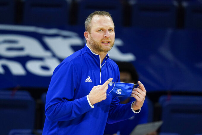 Drake head coach Darian DeVries directs his team during the second half of an NCAA college basketball game against Loyola of Chicago, Sunday, Feb. 14, 2021, in Des Moines, Iowa. Drake won 51-50 in overtime. (AP Photo/Charlie Neibergall)
