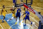 West Virginia guard Taz Sherman shoots as South Dakota State forward Matt Dentlinger defends during an NCAA college basketball game Wednesday, Nov. 25, 2020, in Sioux Falls, S.D. (AP Photo/Josh Jurgens)