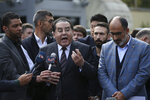 Ayman Nour, an Egyptian dissident, second left, and Turan Kislakci, right, head of the Turkish-Arab media association talk to the media regarding Saudi journalist Jamal Khashoggi, near Saudi Arabia's consulate in Istanbul, Saturday, Oct. 20, 2018. Turkey will