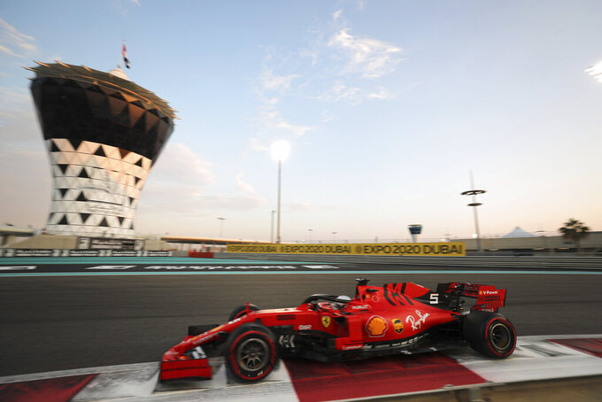 Ferrari driver Sebastian Vettel of Germany steers his car during the qualifying session at the Yas Marina racetrack in Abu Dhabi, United Arab Emirates, Saturday, Nov. 30, 2019. The Emirates Formula One Grand Prix will take place on Sunday. (AP Photo/Kamran Jebreili)