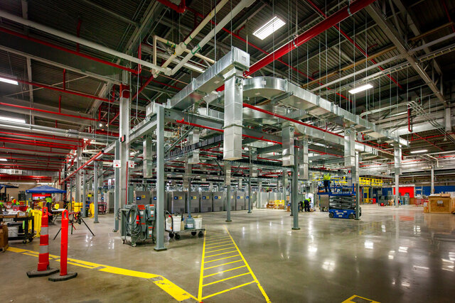 This October 2020 photo provided by Pfizer shows freezers set up in a warehouse in Kalamzoo, Mich., in preparation for distribution of the company's coronavirus vaccine. (Pfizer via AP)