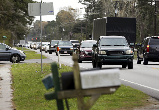 This March 5, 2018 photo shows traffic on Highway 41 in Mt. Pleasant, S.C.  Charleston County's proposal to widen S.C. Highway 41 has drawn thousands of public comments. Some supporters call the road through the historic Black community of Phillips the cost-effective, obvious choice. Others decried it as a discriminatory plan that puts the burden on those with least political power.   (Grace Beahm Alford/The Post And Courier via AP)