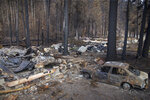 The remains of the Lazy Days RV Park east of Blue River, Ore,. Sept. 22, 2020, are seen after a wildfire swept through the area east of Springfield, Ore., two weeks earlier. (Chris Pietsch/The Register-Guard via AP)