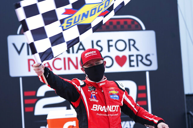 Justin Allgaier (7) celebrates in Victory Lane after winning a NASCAR Xfinity Series auto race Saturday, Sept. 12, 2020, in Richmond, Va. Allgaier swept the two days of racing in the Xfinity Series. (AP Photo/Steve Helber)