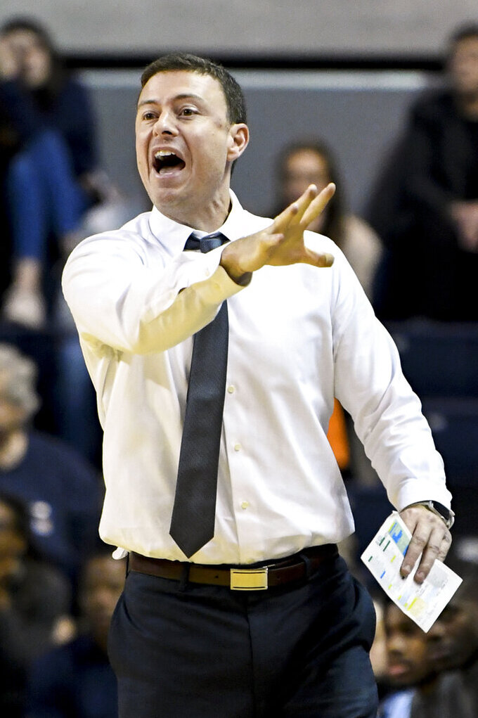 FILE - In this Nov. 5, 2019, file photo then-Georgia Southern head coach Mark Byington calls a play during the first half of an NCAA college basketball game against Auburn, in Auburn, Ala. Byington is now the head coach at James Madison. Byington has five Division I transfers joining the program he took over in March. (AP Photo/Julie Bennett, File)