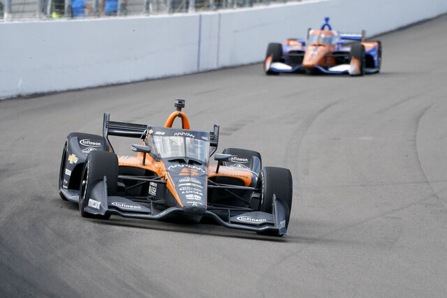 Pato O'Ward (5) leads Scott Dixon (9) during the IndyCar auto race at World Wide Technology Raceway on Sunday, Aug. 30, 2020, in Madison, Ill. (AP Photo/Jeff Roberson)