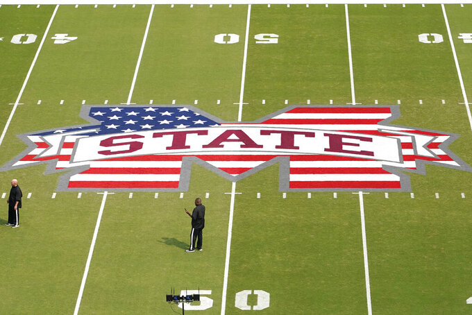 Part of a U.S flag is painted in the school's emblem midfield at Davis Wade Stadium at Scott Field in Starkville, Miss.,. Saturday, Sept. 11, 2021, for the NCAA college football game between North Carolina State and Mississippi State, on the 20th anniversary of the Sept. 11 attacks.  (AP Photo/Rogelio V. Solis)