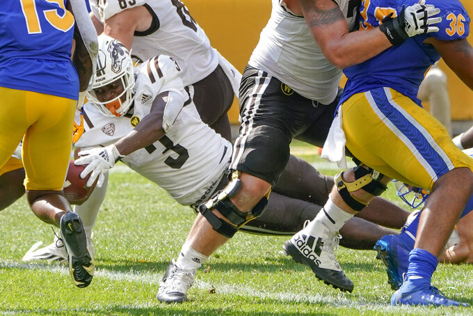 Western Michigan running back La'Darius Jefferson (3) extends the ball into the end zone for a touchdown during the second half of an NCAA college football game against Pittsburgh, Saturday, Sept. 18, 2021, in Pittsburgh. Western Michigan won 44-41. The play was reviewed and confirmed a score. (AP Photo/Keith Srakocic)