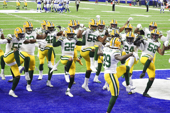 The Green Bay Packers celebrate a touchdown Sunday, Nov. 22, 2020 during an NFL game against the Indianapolis Colts in Indianapolis. The Colts defeated the Packers 34-31. (Margaret Bowles via AP)