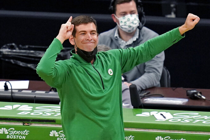 Boston Celtics head coach Brad Stevens calls to his players during the first half of an NBA basketball game against the Denver Nuggets, Tuesday, Feb. 16, 2021, in Boston. (AP Photo/Charles Krupa)