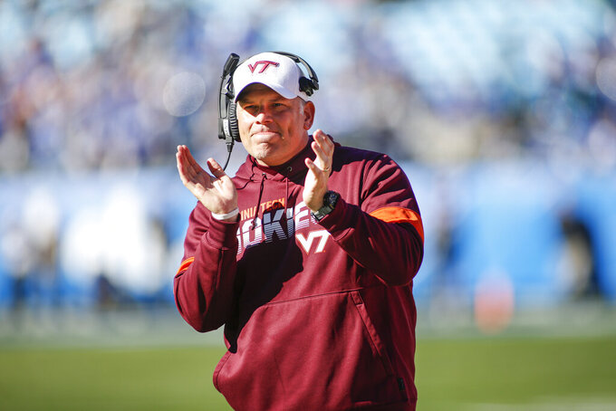 FILE - Virginia Tech head coach Justin Fuente celebrates after his team scored against Kentucky in the first half of the Belk Bowl NCAA college football game in Charlotte, N.C., Tuesday, Dec. 31, 2019. Virginia Tech will take on a different look in the fifth season of the Justin Fuente era.(AP Photo/Nell Redmond, File)