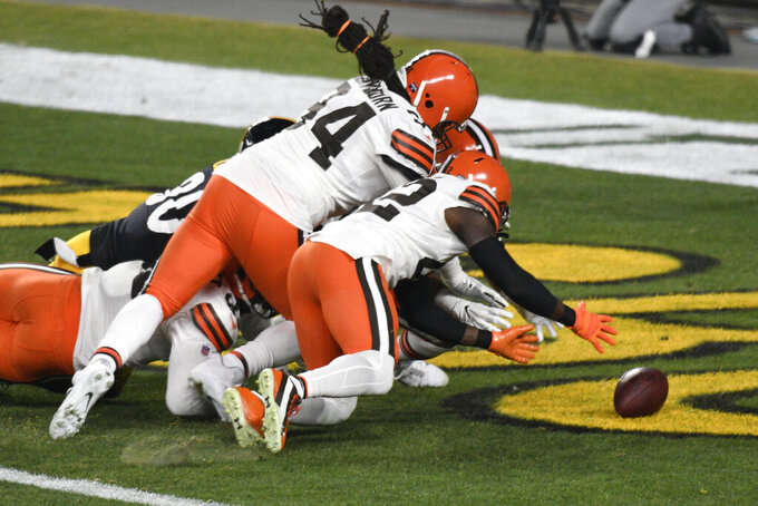 Cleveland Browns strong safety Karl Joseph (42) recovers a fumble in the end zone for a touchdown during the first half of an NFL wild-card playoff football game against the Pittsburgh Steelers in Pittsburgh, Sunday, Jan. 10, 2021. (AP Photo/Don Wright)