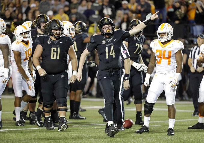 Vanderbilt quarterback Kyle Shurmur (14) signals a first down in the second half of an NCAA college football game against Tennessee, Saturday, Nov. 24, 2018, in Nashville, Tenn. (AP Photo/Mark Humphrey)