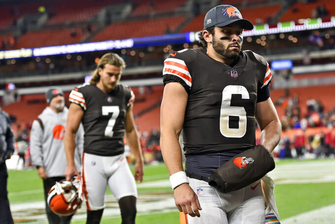 Cleveland Browns quarterback Baker Mayfield walks off the field after the Arizona Cardinals defeated the Browns 37-14 in an NFL football game, Sunday, Oct. 17, 2021, in Cleveland. (AP Photo/David Richard)