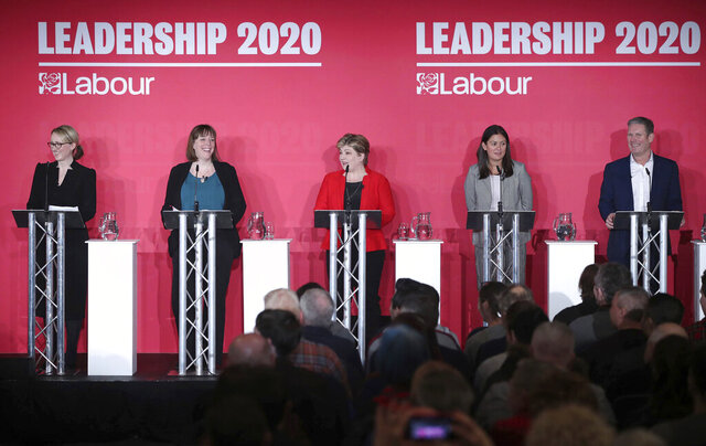 From left, Labour Members of Parliament, Rebecca Long-Bailey, Jess Phillips, Emily Thornberry, Lisa Nandy and Keir Starmer stand on the stage, during the first Labour leadership hustings at the ACC Liverpool, in Liverpool, England, Saturday, Jan. 18, 2020. (Danny Lawson/PA via AP)
