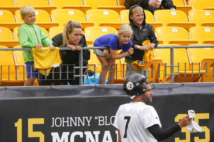 Pittsburgh Steelers quarterback Ben Roethlisberger (7) talks with his family in a break from an NFL football practice, Wednesday, Aug. 18, 2021, in Pittsburgh. His five-year-old son Bodie is at left, his wife, Ashley Harlan, then seven-year-old daughter Baylee, and eight-year-old Benjamin. (AP Photo/Keith Srakocic)