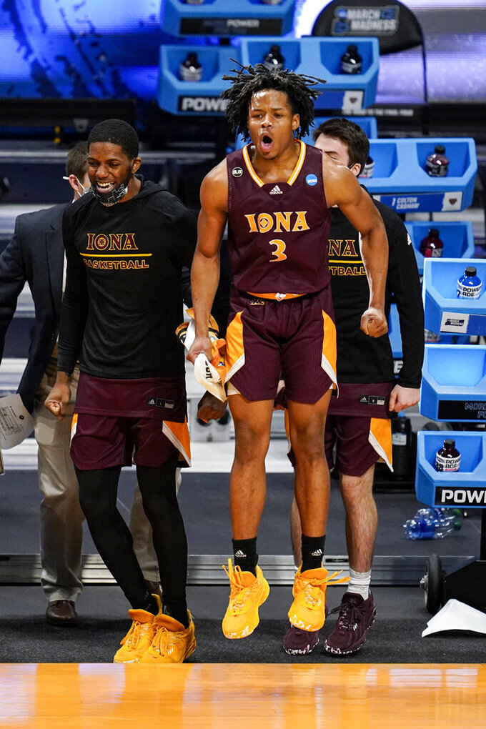 Iona guard Ryan Myers (3) celebrates on the bench in the first half of a first-round game against Alabama in the NCAA men's college basketball tournament at Hinkle Fieldhouse in Indianapolis, Saturday, March 20, 2021. (AP Photo/Michael Conroy)
