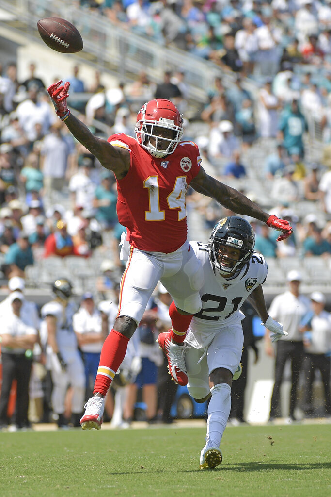 Kansas City Chiefs wide receiver Sammy Watkins (14) cannot hang on to a pass as Jacksonville Jaguars cornerback A.J. Bouye (21) defends during the first half of an NFL football game Sunday, Sept. 8, 2019, in Jacksonville, Fla. (AP Photo/Phelan M. Ebenhack)