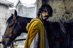"""This image released by A24 shows Dev Patel in a scene from """"The Green Knight."""" (Eric Zachanowich/A24 Films via AP)"""