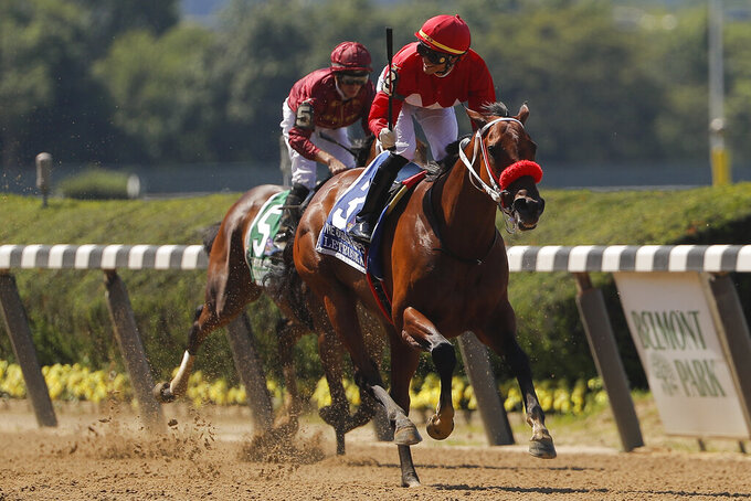 Jose Ortiz, right, reacts as he crosses the finish line with Letruska (3) to win the 53rd running of the Ogden Phipps horse race, Saturday, June 5, 2021, at Belmont Park in Elmont, N.Y. (AP Photo/Julie Jacobson)