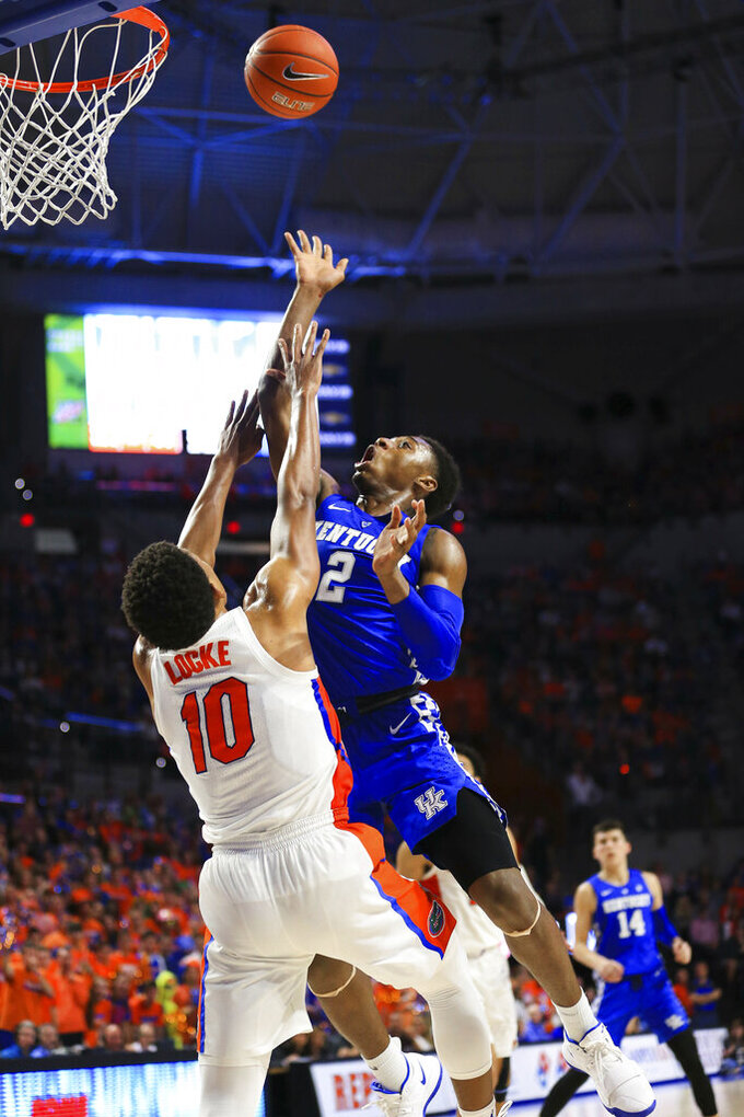 Kentucky guard Ashton Hagans takes a shot over Florida guard Noah Locke during the second half of an NCAA college basketball game Saturday, Feb. 2, 2019, in Gainesville, Fla. Kentucky defeated Florida 65-54. (AP Photo/Matt Stamey)