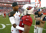 Tampa Bay Buccaneers quarterback Jameis Winston, left, talks to Arizona Cardinals quarterback Kyler Murray after an NFL football game Sunday, Nov. 10, 2019, in Tampa, Fla. (AP Photo/Jason Behnken)