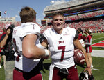Troy quarterback Kaleb Barker (7) walks off the field with the game ball following an NCAA college football game against Nebraska in Lincoln, Neb., Saturday, Sept. 15, 2018. Troy won 24-19. (AP Photo/Nati Harnik)