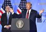 U.S. President Donald Trump raises his hands during a press conference after a summit of heads of state and government at NATO headquarters in Brussels, Belgium, Thursday, July 12, 2018. NATO leaders gather in Brussels for a two-day summit. (AP Photo/Geert Vanden Wijngaert)